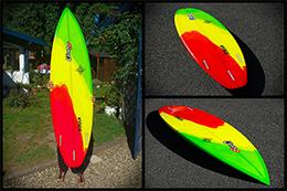 Planche de surf couleurs rasta